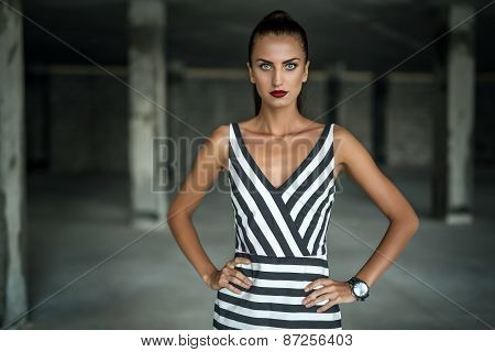 Fashion model in a striped dress