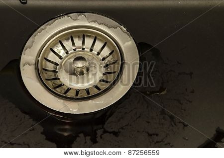Metal sifter at kitchen sink