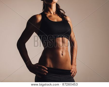 Muscular Young Woman In Sportswear