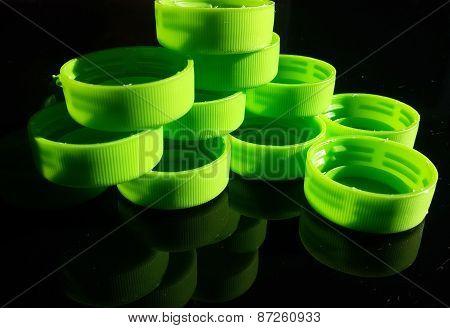 Green plastic lids