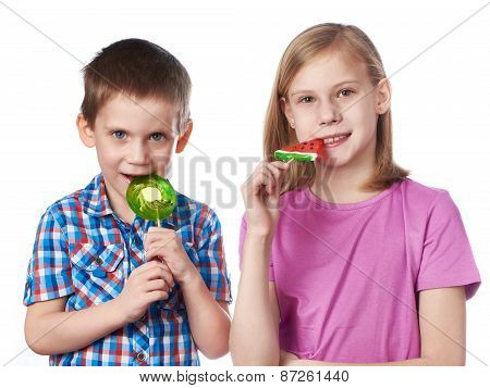 Girl And Boy Eating A Lollipops