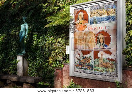 FUNCHAL, MADEIRA - MAR 10 : A  statue and plaque line a path in the Monte Palace Tropical Gardens.