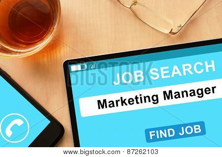 Tablet with Marketing Manager on job search site.