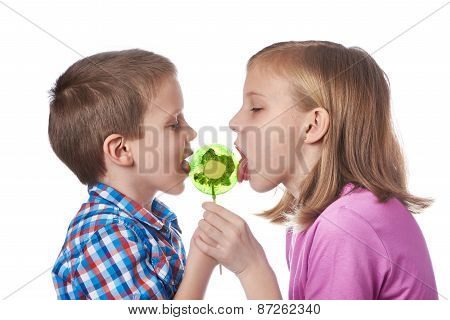 Girl And Boy Eating A Lollipop