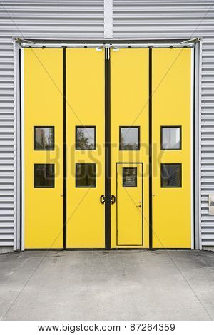 Yellow Garage Door on a warehouse building