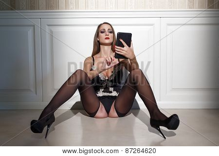 Sexy Woman In Black Underwear With Tablet Sit On Floor