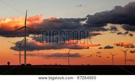 Wind Power Plant Silhouettes In Sunset