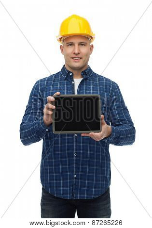 repair, construction, building, people and maintenance concept - smiling male builder or manual worker in helmet showing tablet pc computer blank screen