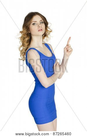 Young Woman pointing up at copy space over white background