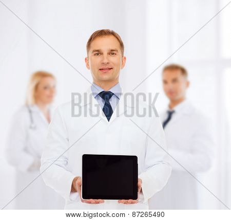 medicine, advertisement and teamwork concept - smiling male doctor showing tablet pc computer screen over group of medics