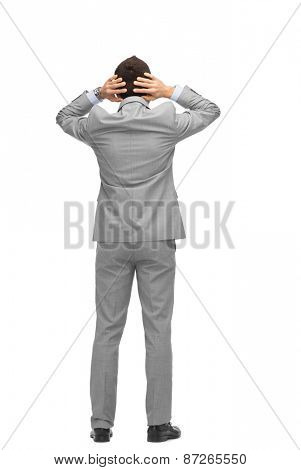 business, people, crisis, rear view and office concept - businessman grabs his head from back