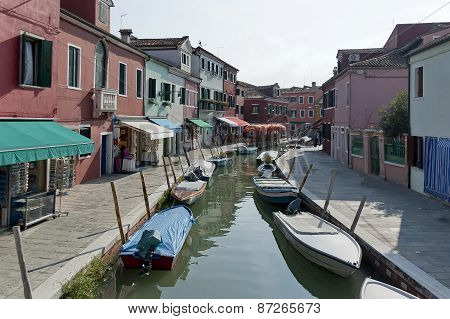 Colorful houses and canal on Burano island, near Venice