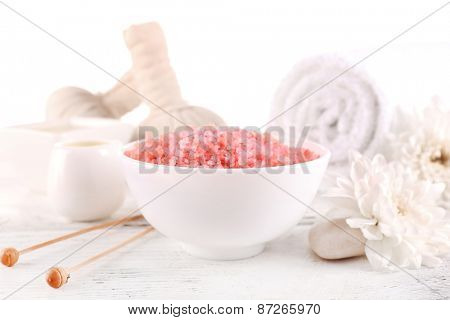 Spa still life with color sea salt on wooden table, closeup