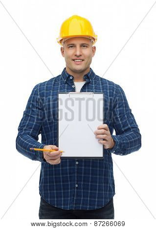repair, construction, building, people and maintenance concept - smiling male builder or manual worker in helmet with clipboard
