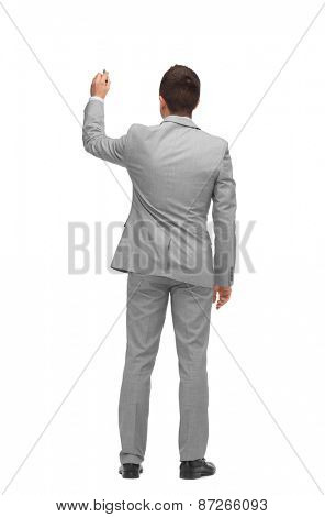 business, people, advertisement , information and office concept - businessman writing or drawing something imaginary from back