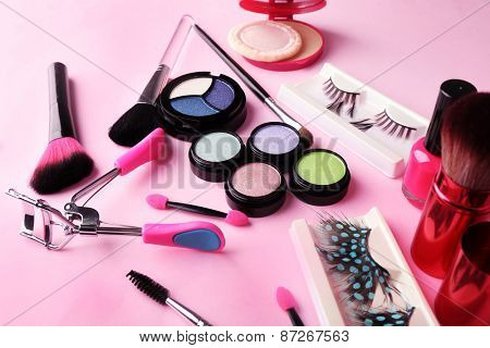 Set of decorative cosmetics on light colorful background