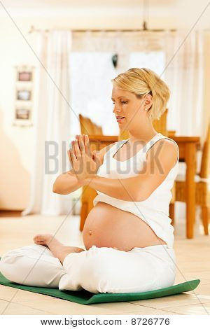 Pregnant woman doing pregnancy yoga
