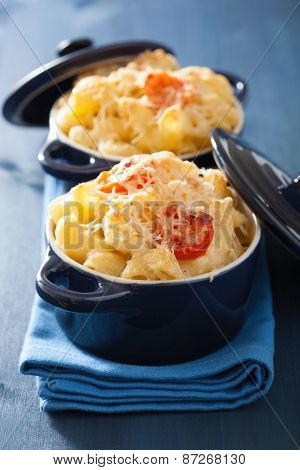baked macaroni with cheese in blue casserole