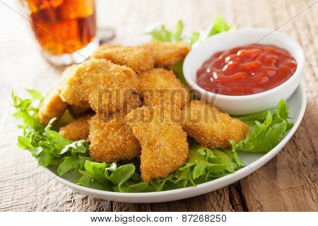fast food chicken nuggets with ketchup, french fries, cola