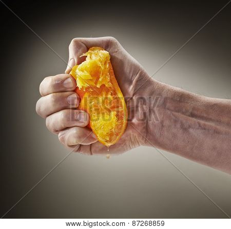 Fresh Squeezed Orange Juice By Male Hand