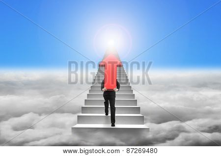 Businessman Carrying Red Arrow Sign On Stairs With Cloudscape Sunlight