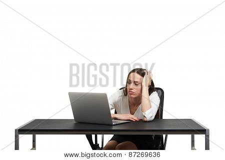 sorrowful woman looking at laptop. isolated on white background