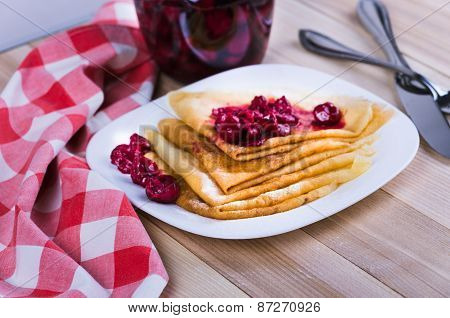 Pancakes With Jam And Berries On A Plate