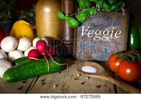 A Lots Of Healthy Vegetables On A Wooden Table, Sign With Word Veggie