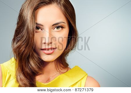 Close-up portrait of a beautiful young woman with gentle features. Beauty, fashion. Skincare, healthcare. Studio shot.