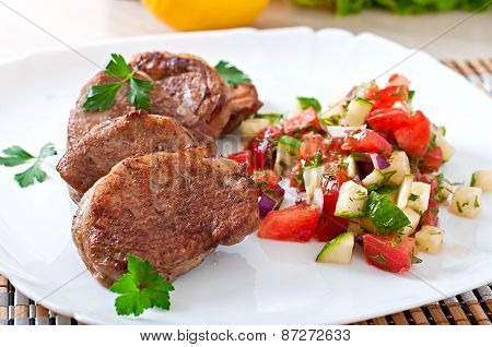 Pork medallions with salsa
