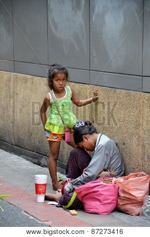 Unidentified Beggars Beg For Money On The Street In Bangkok, Thailand