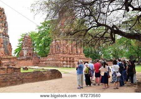 Tourists Visit Wat Chaiwatthanaram In Ayutthaya, Thailand