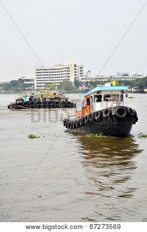 Tug Boat Drags Sand Barge On Chao Phraya River, Bangkok