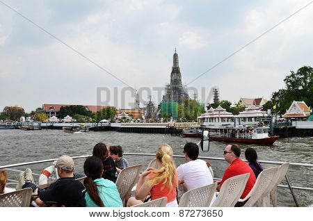 Tourists Cruise In The Chao Phraya River In Bangkok, Thailand
