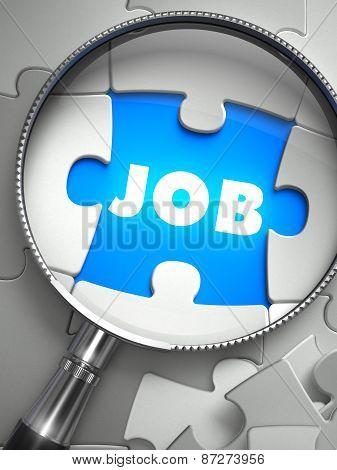 Job - Missing Puzzle Piece through Magnifier.