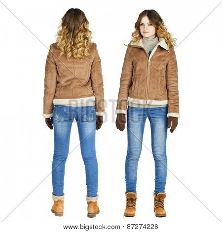 Young beautiful girl in a leather sheepskin coat and blue jeans isolated on white background