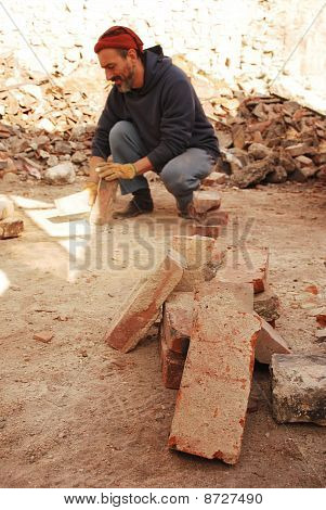 Man Scraping Bricks