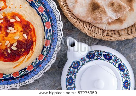 Hummus Served With Pita Bread And Tea