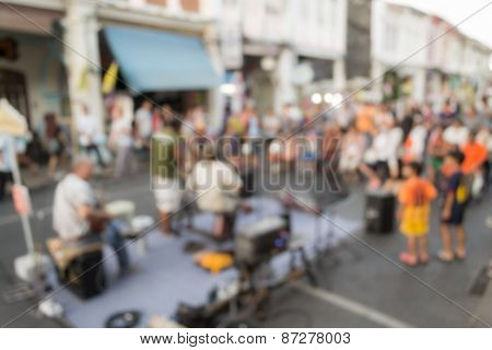 Blurred People Watching A Performance On The Street, Phuket, Thailand