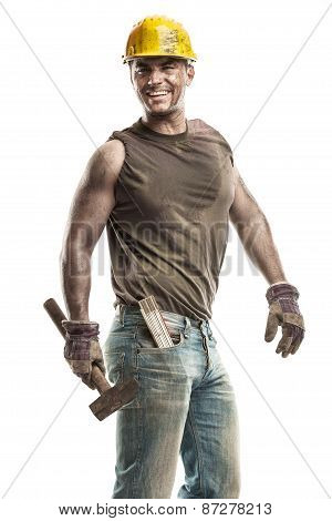 Young Dirty Worker Man With Hard Hat Helmet  .holding A Hammer And Smiling