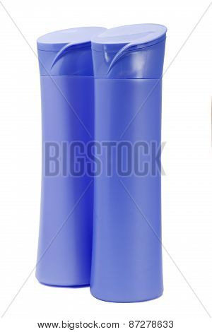 Two Violet Plastic Bottles Isolated On A White Background