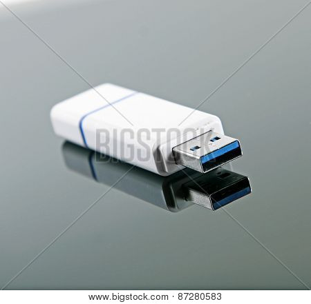 Usb Flash Drive With Reflection On Glossy Background