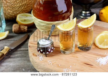 Two Glasses Of Tequila With Lemon And Salt