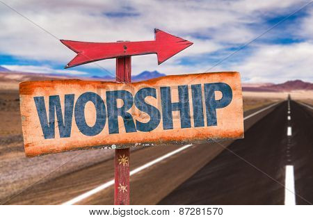 Worship sign with road background