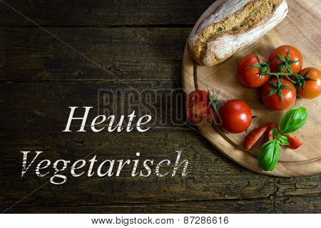 Tomatoes With Bread On Wooden Table, Text Heute Vegetarisch