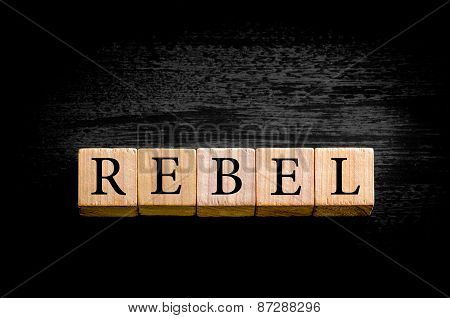 Word REBEL Isolated On Black Background