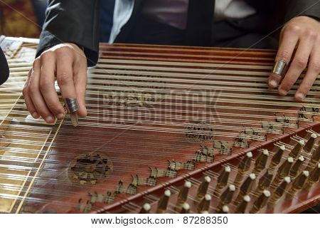 Fingers Playing Arabian Qanon Musical Instrument