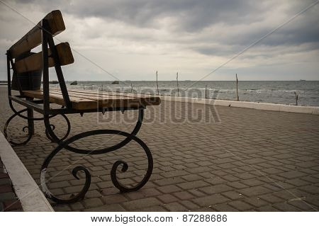 Empty Bench On The Promenade In Cloudy Weather