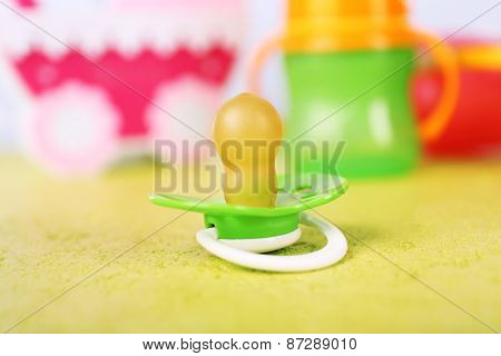 Dummy for baby, close-up, on bright background