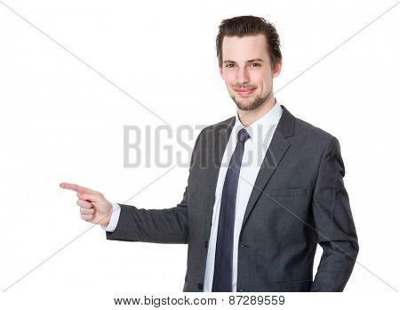 Handsome businessman or attorney or politician pointing aside